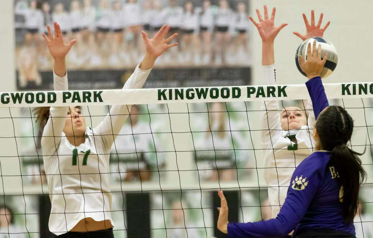 Kingwood Park outside hitter Charlee Jordan (17) and defensive specialist Camryn Knight (3) block a play from Montgomery right side hitter Skyla Roth (9) during the second set of a District 20-5A volleyball match at Kingwood Park High School in Kingwood.