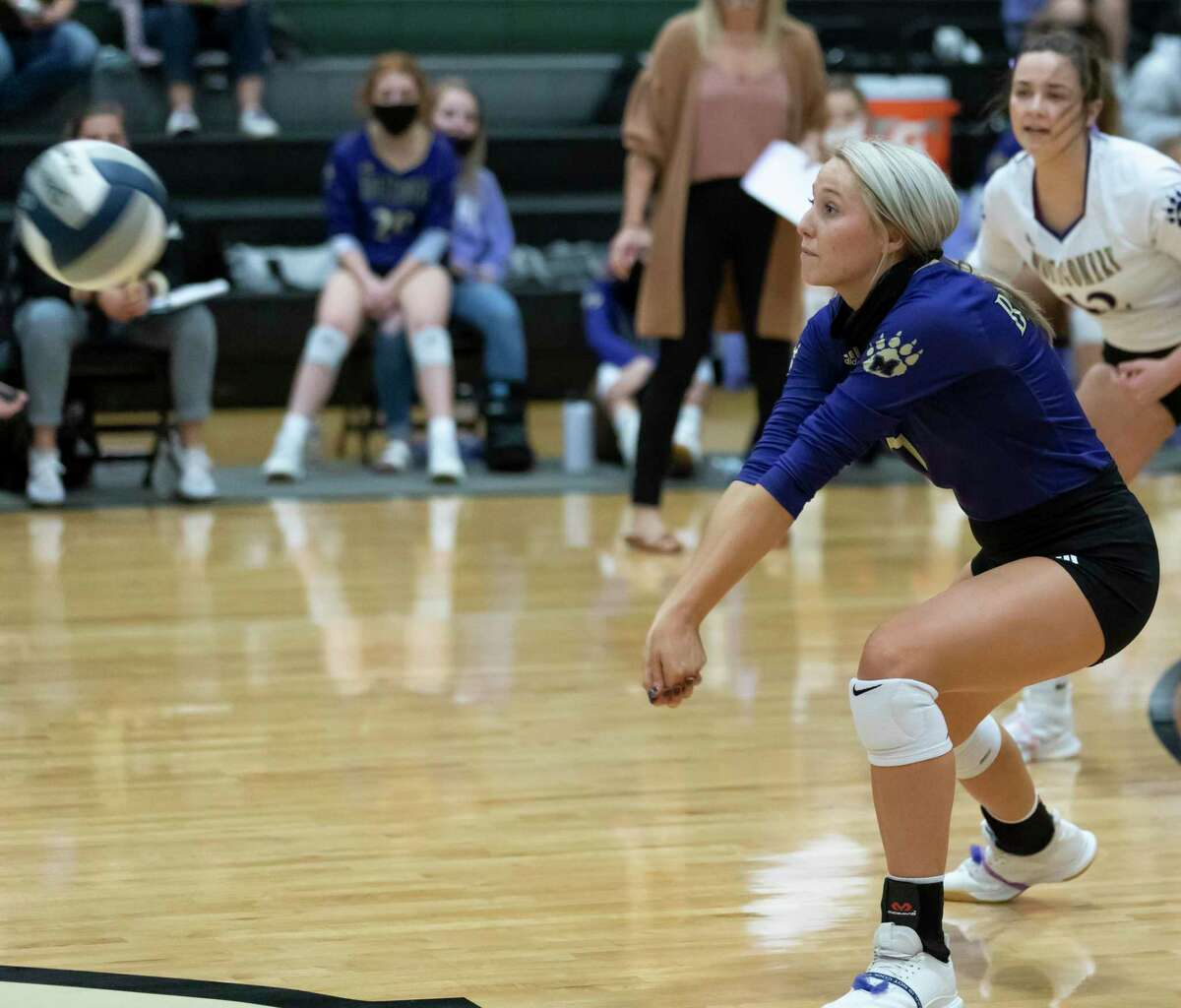 Montgomery outside hitter Emma Ely (7) returns a servev during the first set of a District 20-5A volleyball match at Kingwood Park High School in Kingwood.