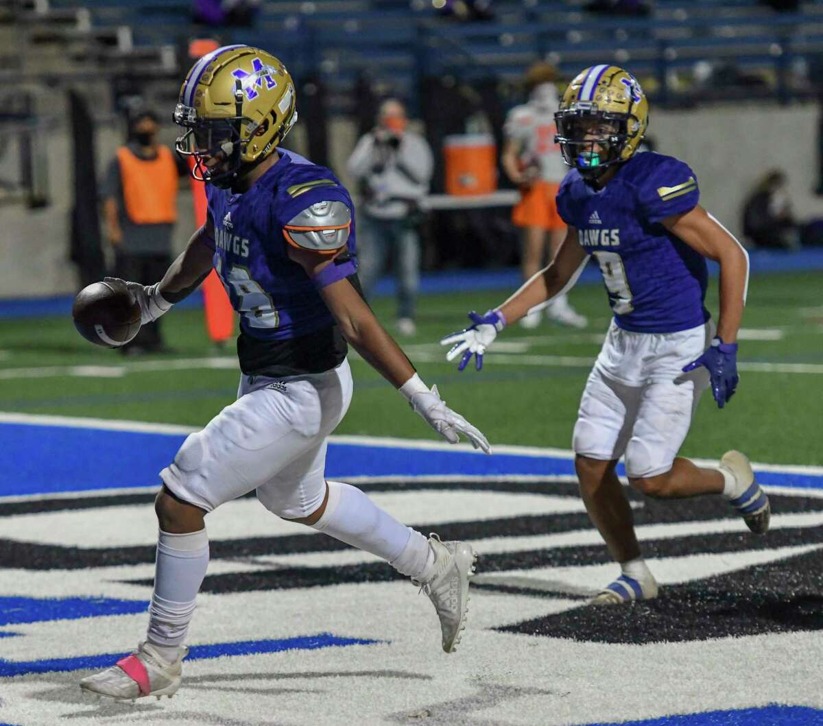 Midland High's Matteo Houston scores a touchdown while Brian'Zai Perez (9) follows him into the end zone Friday, Nov. 6, 2020 at Grande Communications Stadium. Jacy Lewis/Reporter-Telegram