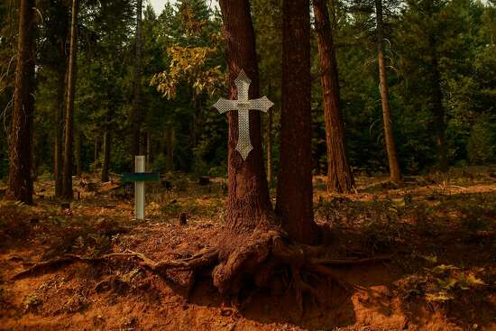 Crosses on Ponderosa Way, a road which was once used as a firebreak, marks the spot where Michael Owens died in 2014, on Tuesday, Sept. 29, 2020 in Butte County, California.
