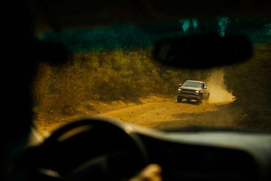 A truck drives down Ponderosa Way which was once used as a firebreak on Tuesday, Sept. 29, 2020 in Butte County, California.