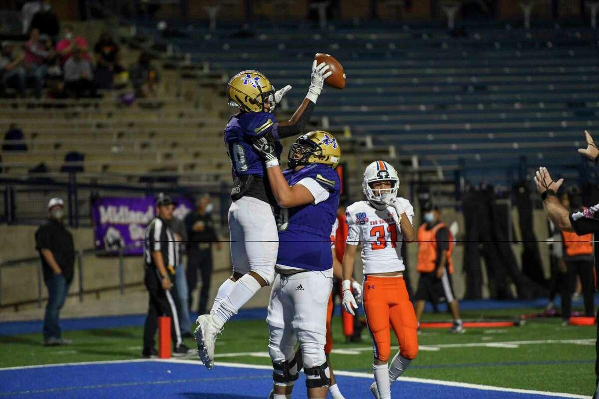 Midland High's Matteo Houston and Brett Canis celebrate a touchdown Friday, Nov. 6, 2020 at Grande Communications Stadium. Jacy Lewis/Reporter-Telegram