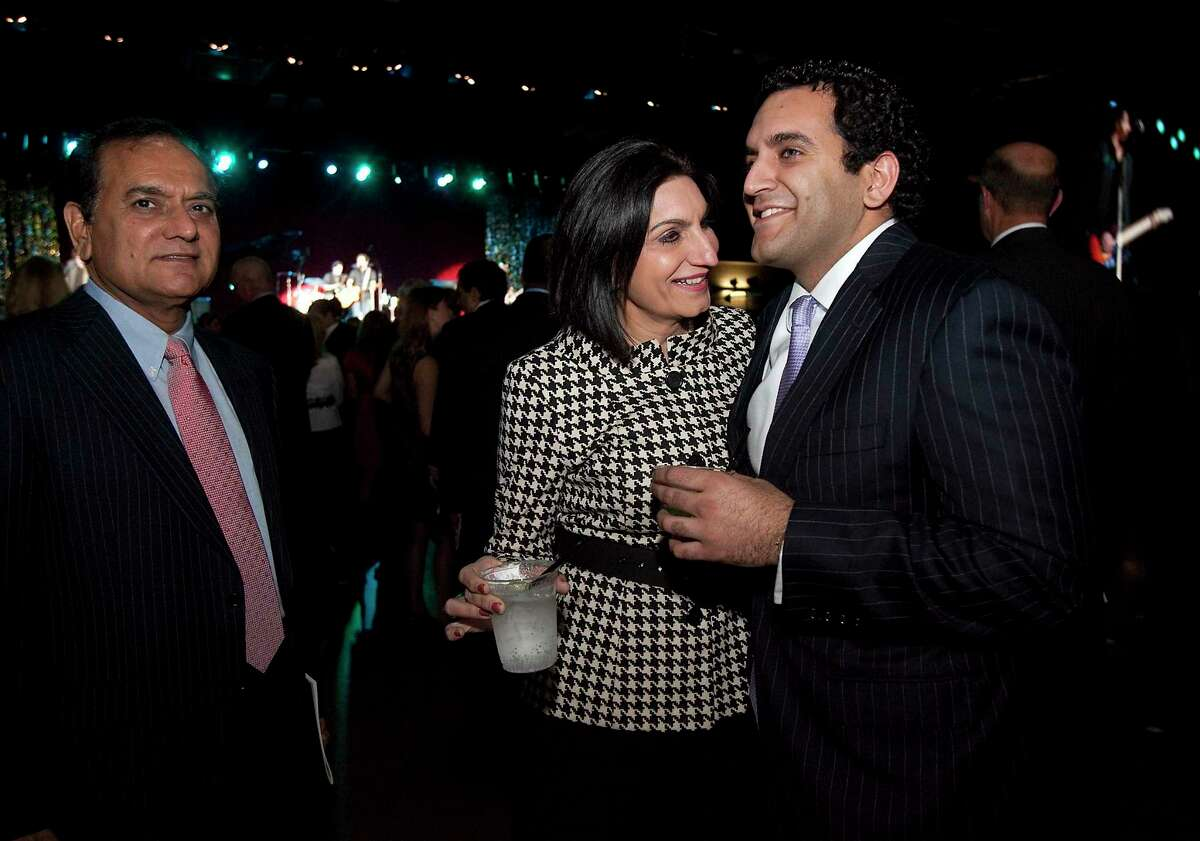 Dr. Love Paul, left, Pearl Paul and their son Nate Paul, right, attend the 2011 Texas Inaugural Celebration at the Palmer Events Center in Austin, Texas, on Jan. 18, 2011. Nate Paul, an Austin real estate developer at the center of recent allegations against Texas Attorney General Ken Paxton, asked for an investigation into his uncorroborated claims that other businessmen have an elaborate conspiracy to steal $200 million worth of his properties with the help of a federal judge. In his complaint to prosecutors in Austin, Paul said the owner of a chain of Texas car dealerships schemed with lawyers, investors and others to seize his assets.