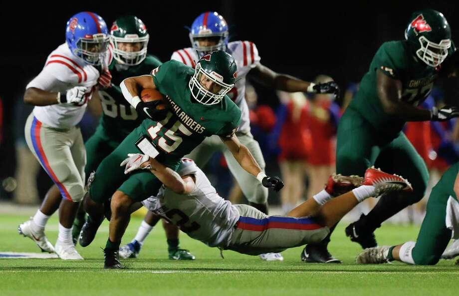The Woodlands running back Lane O'Brien (15) picks up a first down during the third quarter of a District 13-6A high school football game at Woodforest Bank Stadium, Friday, Nov. 6, 2020, in Shenandoah. Photo: Jason Fochtman, Houston Chronicle / Staff Photographer / 2020 © Houston Chronicle