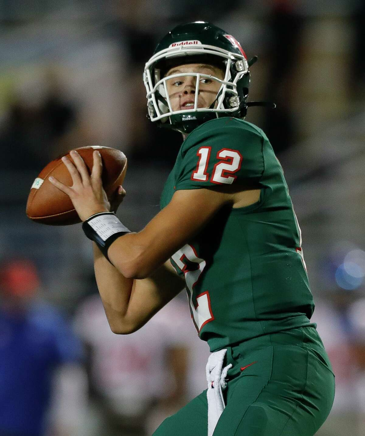 The Woodlands quarterback Connor Dechiro (12) drops back for a 15-yard touchdown pass to wide receiver Jack Calhoun during the third quarter of a District 13-6A high school football game at Woodforest Bank Stadium, Friday, Nov. 6, 2020, in Shenandoah.