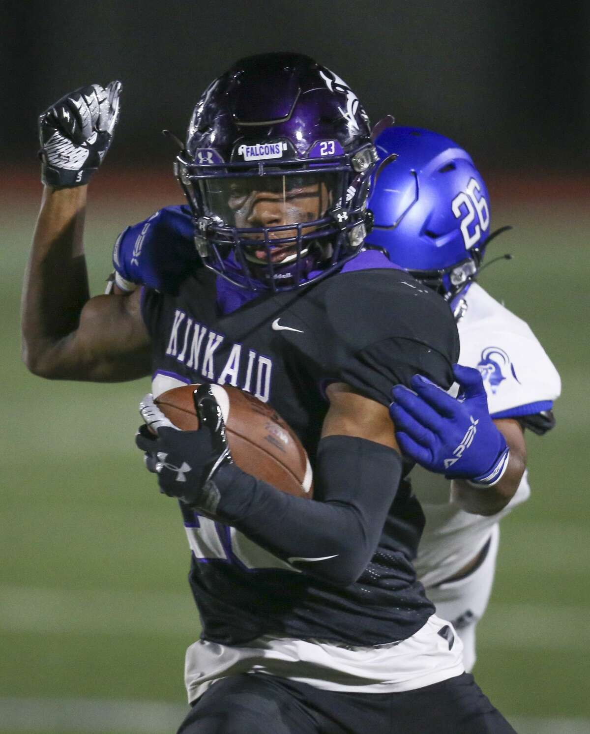 Kinkaid Falcons running back (23) drags Episcopal Knights defensive back Maurice Williams (26) in the first quarter in a division high school football game on November 6, 2020 at Segal Field at Barnard Stadium in Houston, TX.