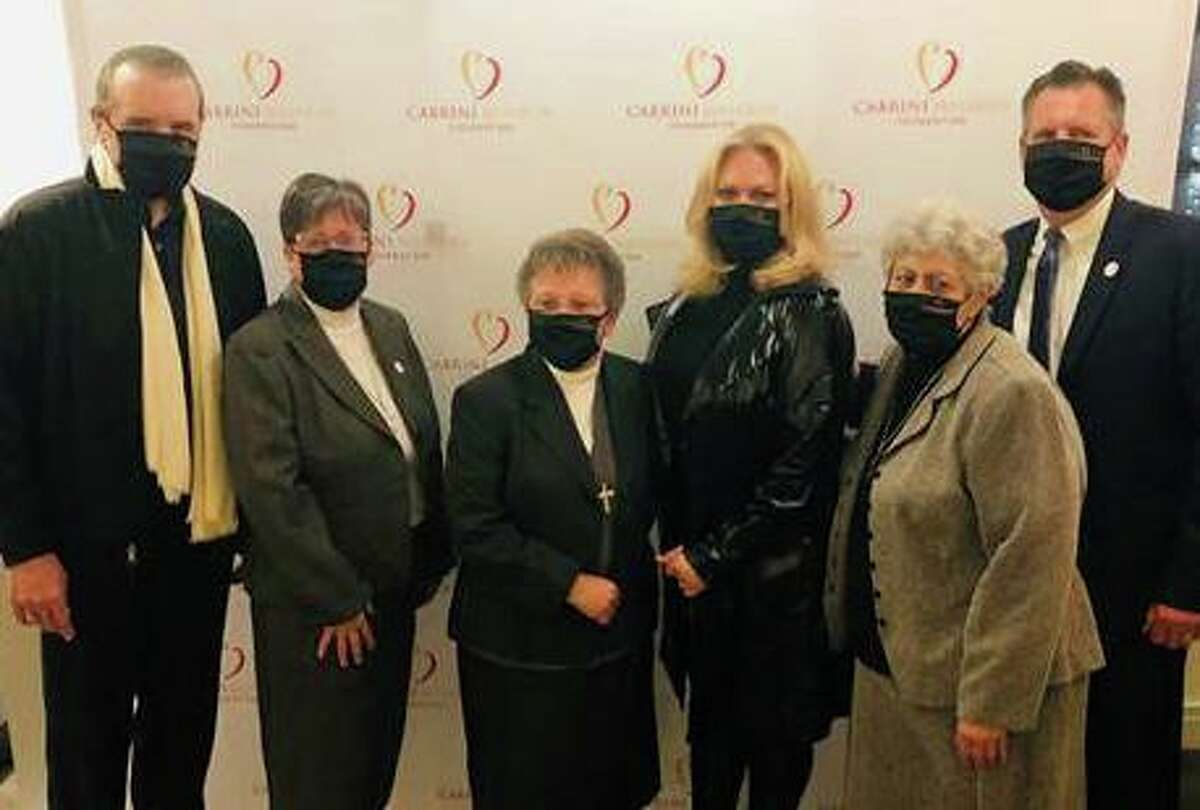 Chaz Palminteri and his wife Giana, residents of Bedford, N.Y., pose with members of the Cabrini Mission Foundation at the Bedford Playhouse where they were honored recently for their contributions to the foundation.