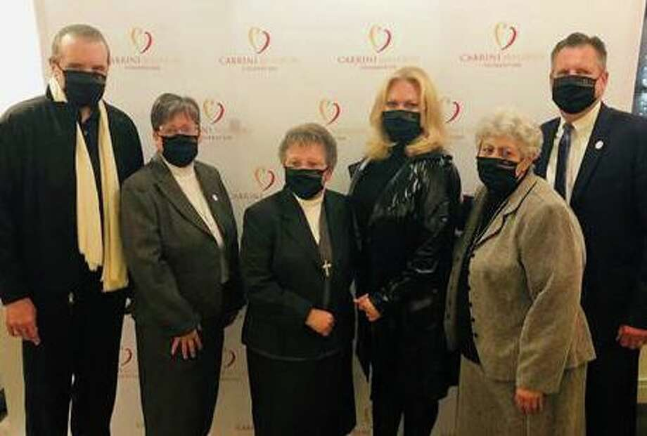 Chaz Palminteri and his wife Giana, residents of Bedford, N.Y., pose with members of the Cabrini Mission Foundation at the Bedford Playhouse where they were honored recently for their contributions to the foundation. Photo: Contributed / Bedford Playhouse /