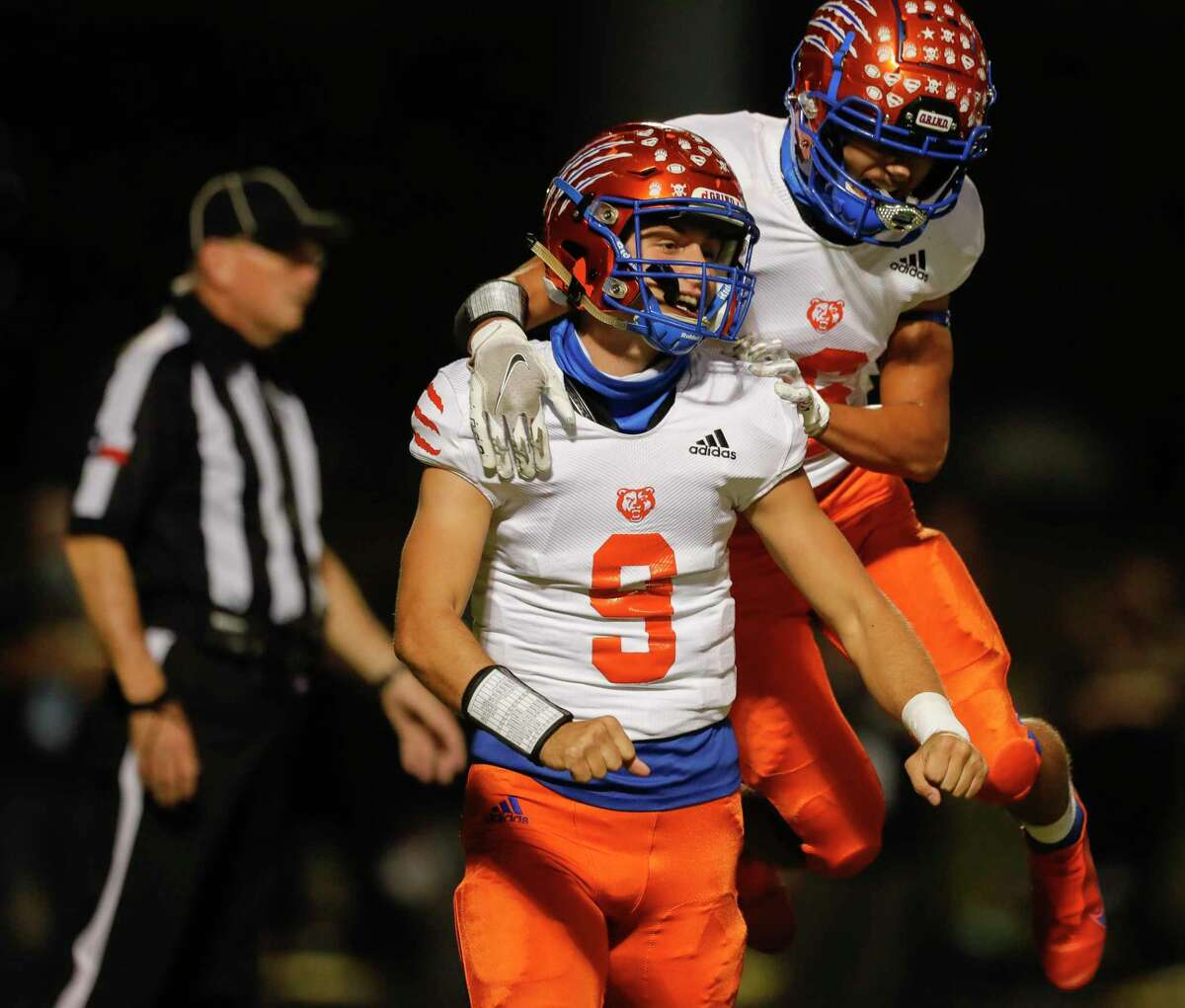 Grand Oaks quarterback James Holmon (9) reacts with wide receiver Seth Wright (16) after running for a 1-yard touchdown during the first quarter of a District 13-6A high school football game at Buddy Moorhead Stadium, Friday, Nov. 6, 2020, in Conroe.