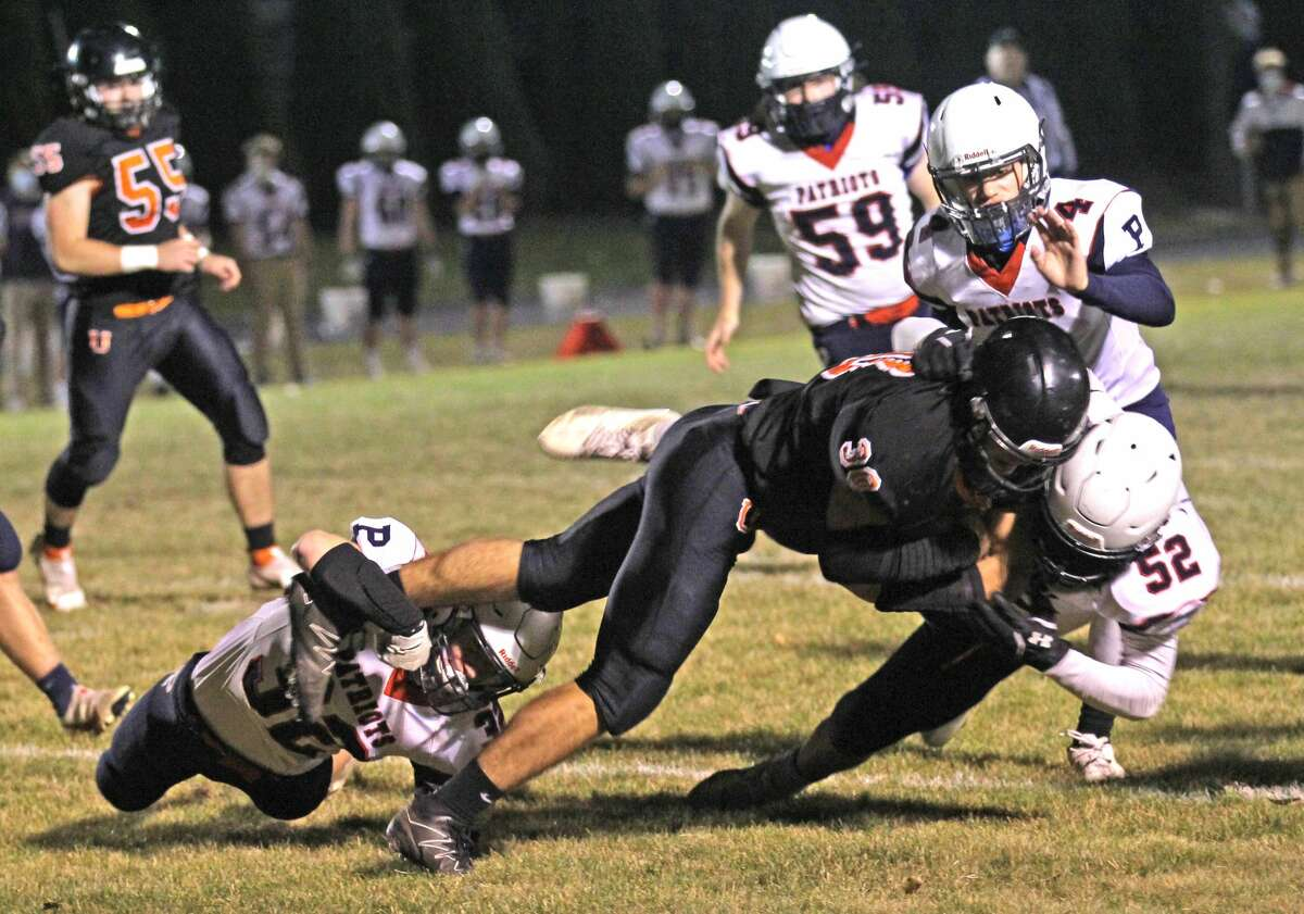 The Ubly Bearcats earned a trip to the district finals after beating the visiting USA Patriots, 20-14, in overtime on Friday night.