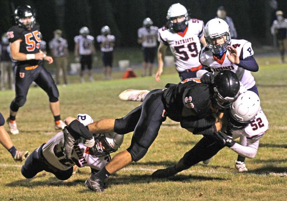 The Ubly Bearcats earned a trip to the district finals after beating the visiting USA Patriots, 20-14, in overtime on Friday night. Photo: Mark Birdsall/Huron Daily Tribune