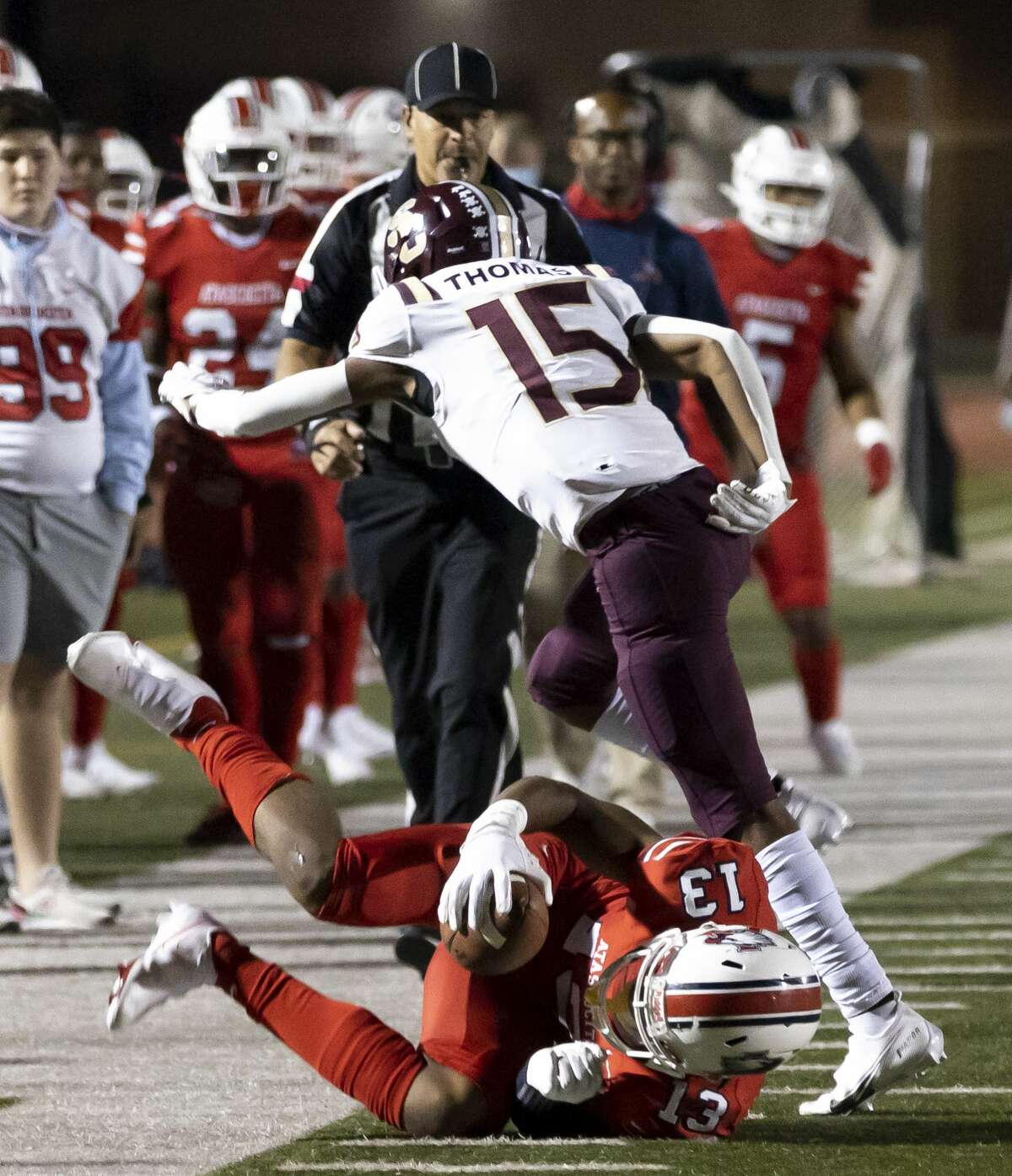 Atascocita wide receiver Landen King (13) is tackled out of bounds by Summer Creek defensive back Myles Thomas (15) during the third quarter of a District 21-6A football game at Turner Stadium in Humble, Friday, Nov. 6, 2020.