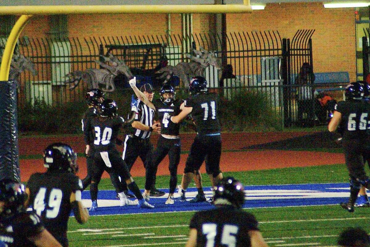 Friendswood's Luke Grden (2), Isaiah Daniels (30), Nolan Smith (4) and Daniel Goolsby (71) celebrate a touchdown against La Porte Friday at Friendswood High School.