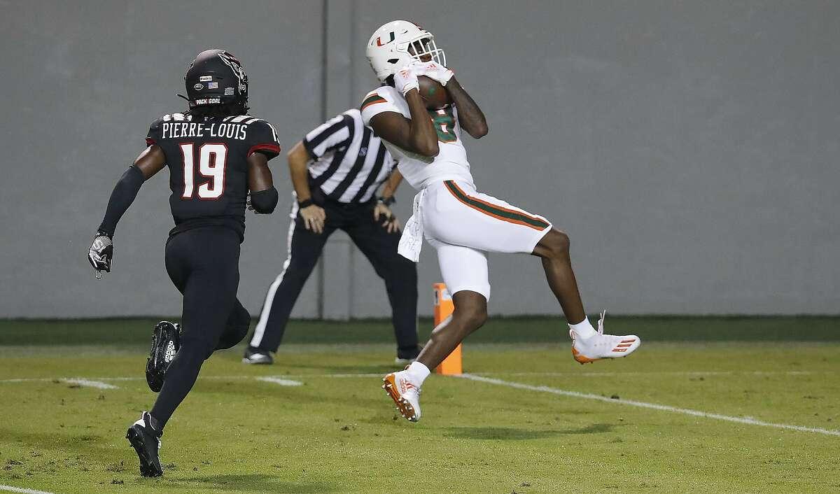 Miami's Dee Wiggins pulls in a 39-yard touchdown reception ahead of N.C. State's Joshua Pierre-Louis.