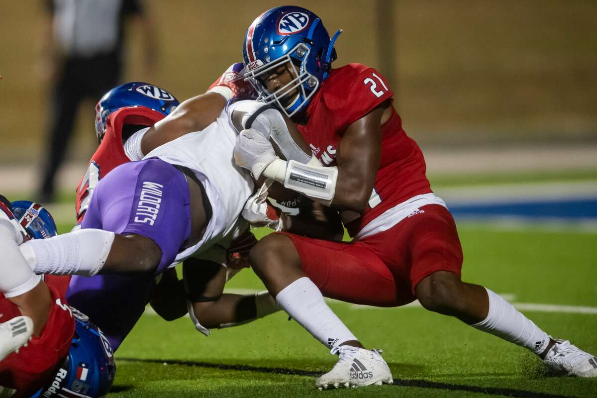 Bruins' Bobby Jones (33) and Reggie Holmes (21) take down a Wildcat ball carrier in the first half. The West Brook Bruins shut down the Humble Wildcats at BISD Memorial Stadium on Friday night. Photo made on November 6, 2020. Fran Ruchalski/The Enterprise