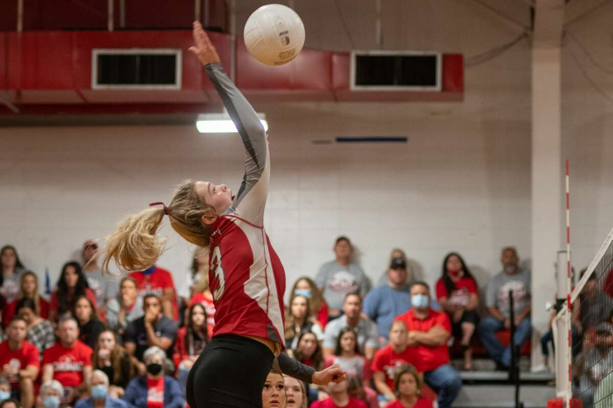BC Harlee Tupper (3) smacks the ball over the net in the second set. The Bridge City Lady Cardinals played Huffman Lady Falcons in a regional quarterfinal volleyball playoff match at Lumberton High School. Photo made on November 6, 2020. Fran Ruchalski/The Enterprise