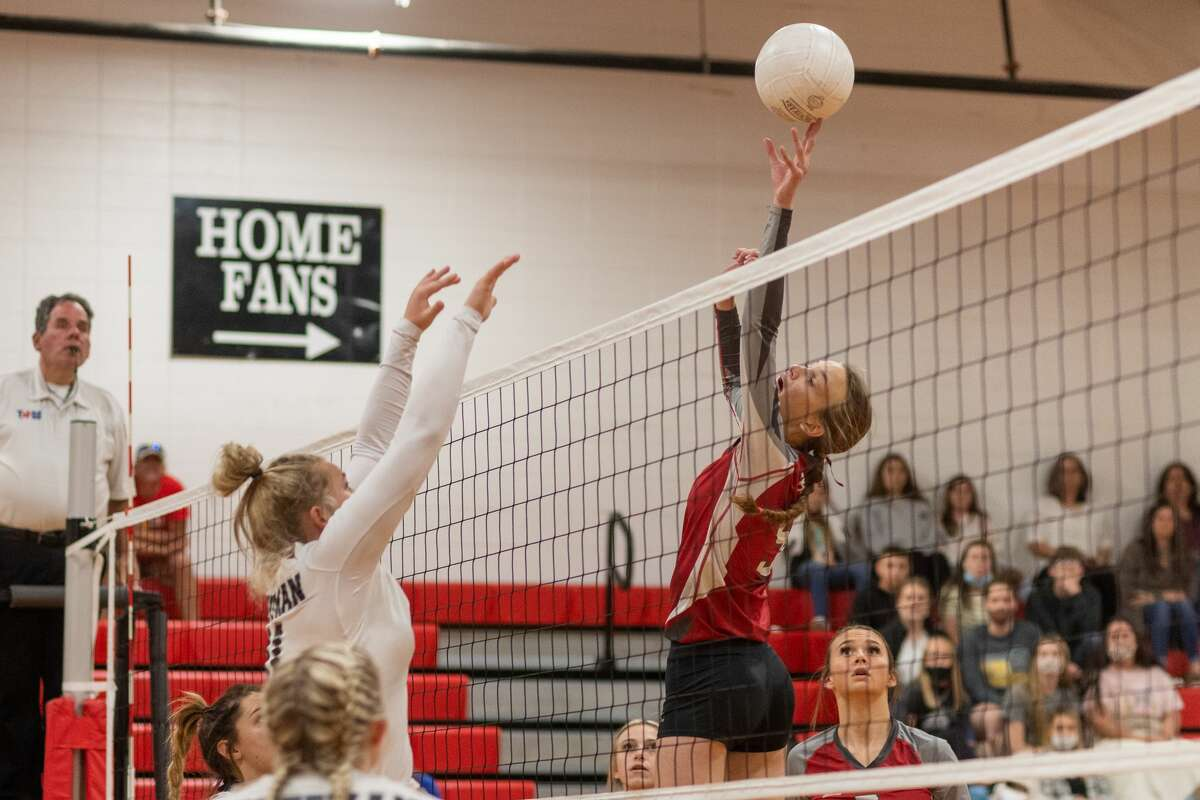 BC Demi Carter (5) puts the ball over with a soft touch. The Bridge City Lady Cardinals played Huffman Lady Falcons in a regional quarterfinal volleyball playoff match at Lumberton High School. Photo made on November 6, 2020. Fran Ruchalski/The Enterprise