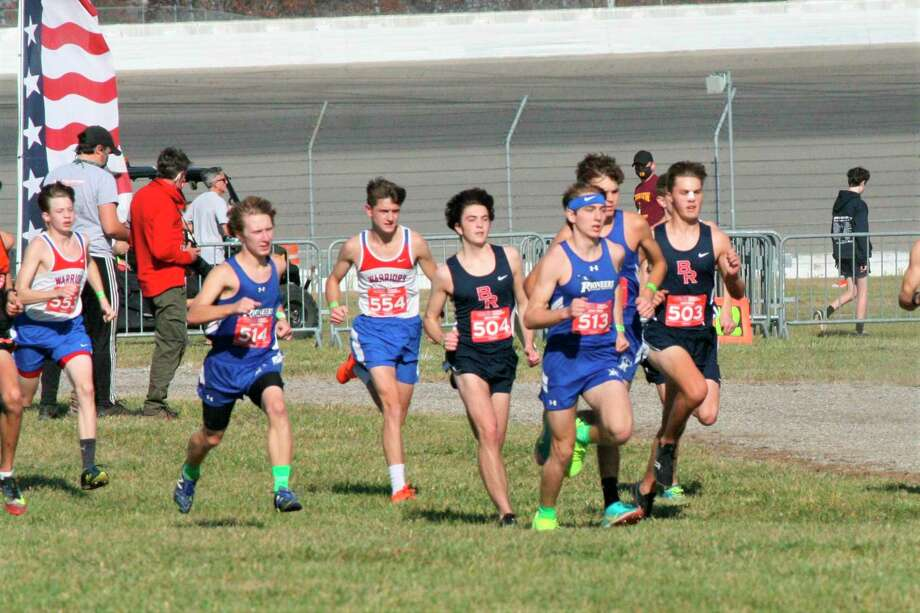 Chippewa Hills runners Aiden Hollandworth (553) and Jake O'Neil (554) and Big Rapids' Ryan Ososki (504) and Ben Knuth (503) work on their pace during Friday's Division 2 state cross country race at Michigan International Speedway. (Courtesy photo)