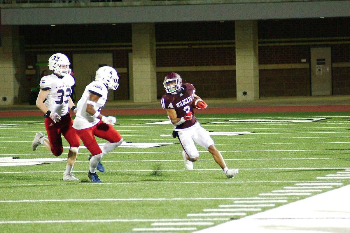 Clear Creek's Jeremiah Crum (3) tries to outrun Clear Lake's Eric Hunter (4) Friday, Nov. 6 at Challenger Columbia Stadium.
