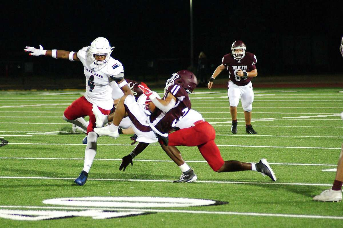 Clear Creek's Jeremiah Crum (3) is knocked off his feet by Clear Lake's Julian Humphrey (12) Friday, Nov. 6 at Challenger Columbia Stadium.
