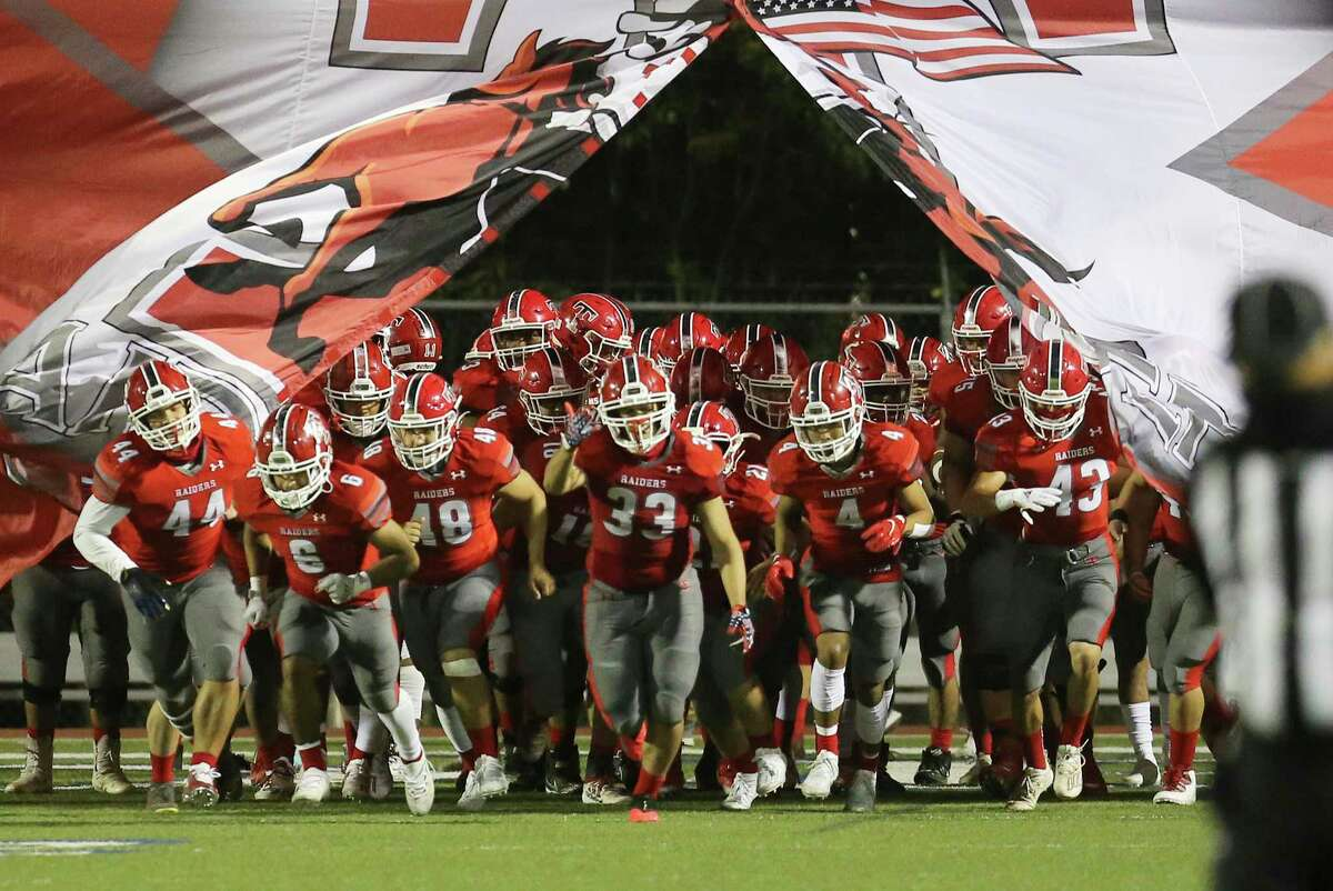 The Taft Raiders take the field against the Warren Warriors for their football game at Farris Stadium on Friday, Nov. 6, 2020.