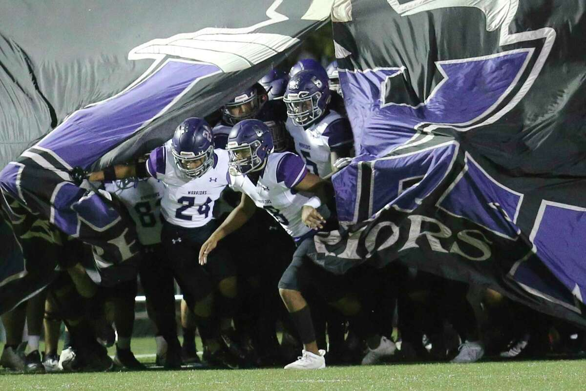 The Warren Warriors take the field against Taft for their football game at Farris Stadium on Friday, Nov. 6, 2020.