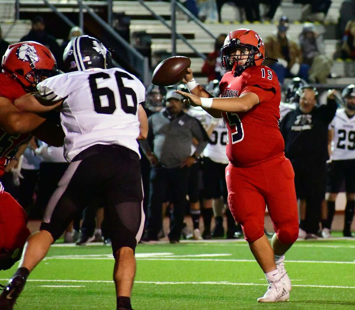Plainview's Issac Garza tries to find a receiver on a pass play during a District 3-5A Division II football game against Canyon Randall on Friday, Nov. 6, 2020 in Greg Sherwood Memorial Bulldog Stadium.