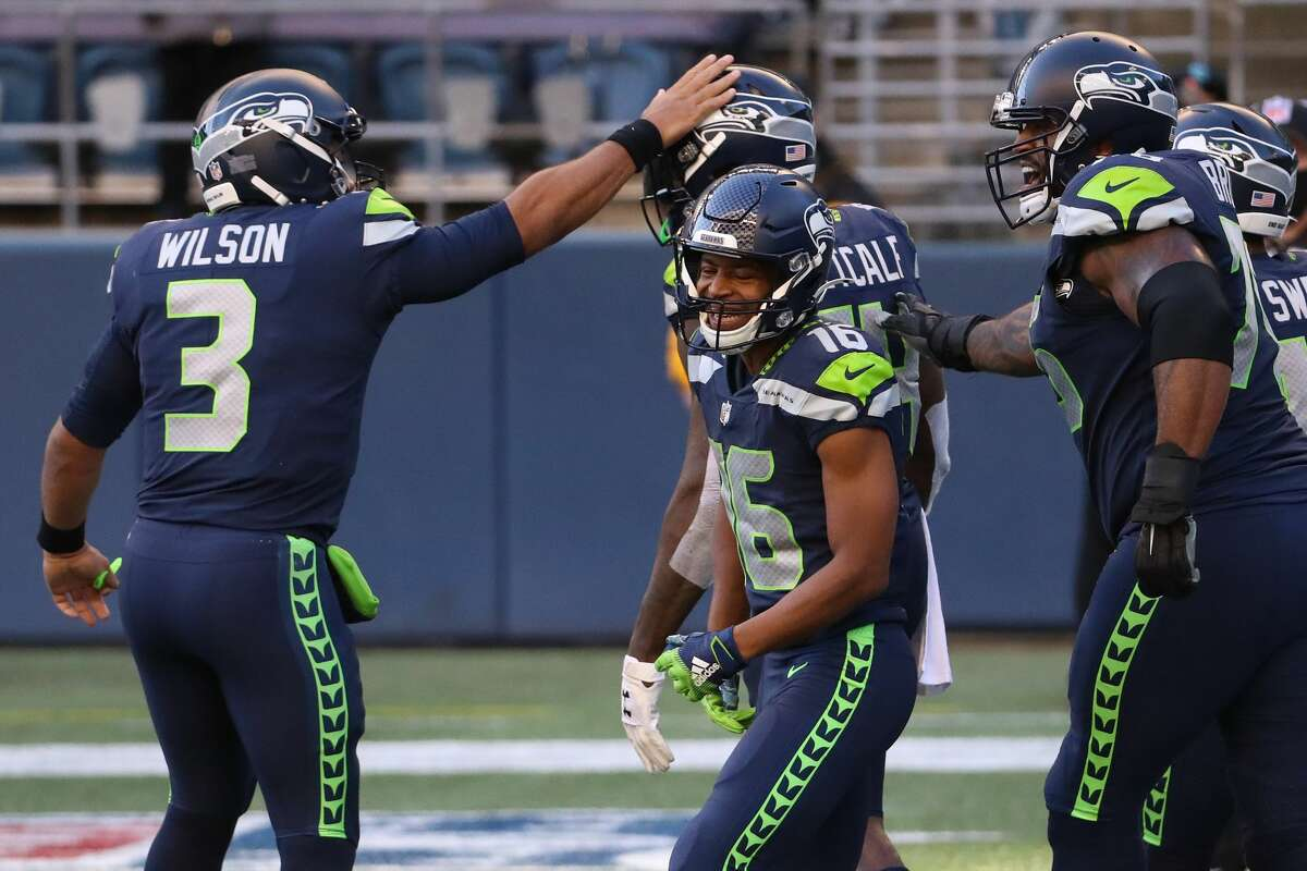 SEATTLE, WASHINGTON - NOVEMBER 01: Quarterback Russell Wilson #3 of the Seattle Seahawks celebrates with teammate DK Metcalf #14 after a touchdown in the second quarter against the San Francisco 49ers at CenturyLink Field on November 01, 2020 in Seattle, Washington. (Photo by Abbie Parr/Getty Images)