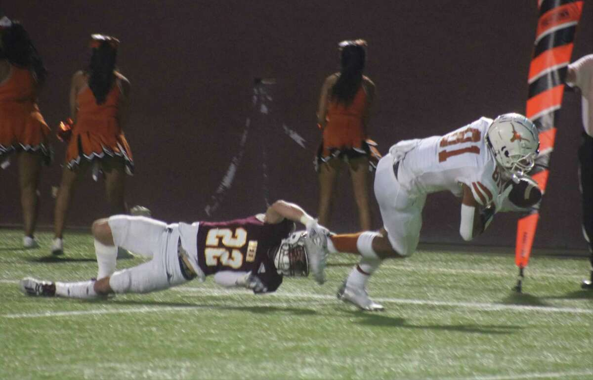 Dobie's Jeremiah Ballard (81) scores a go-ahead touchdown in the first quarter as Deer Park's Kai Twitty can't keep him out of the end zone.