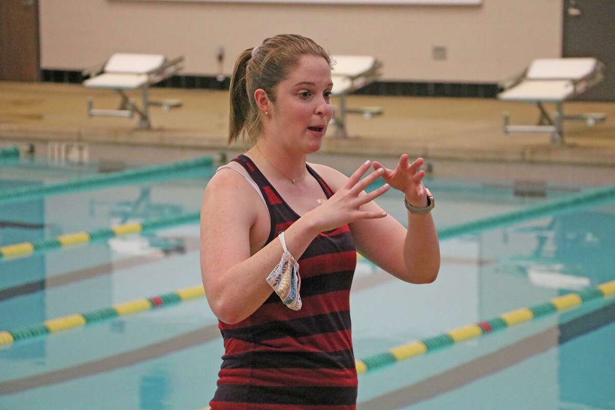 Olympian Cammile Adams visits the Cypress Falls High School swim team Oct. 22, 2020.