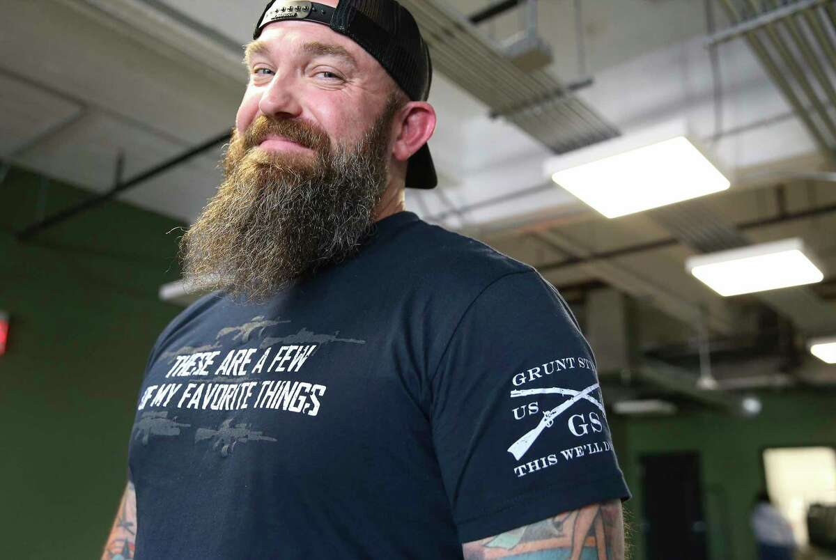 A Grunt Style employee and retired Marine wears a company t-shirt. Larger look at Grunt Style after Daniel Alarik, the founder and former CEO of the military and veteran lifestyle apparel brand, announced Monday that the company terminated him. Current CEO Glenn Silbert responds and defends his company to claims of a toxic culture and staff issues.