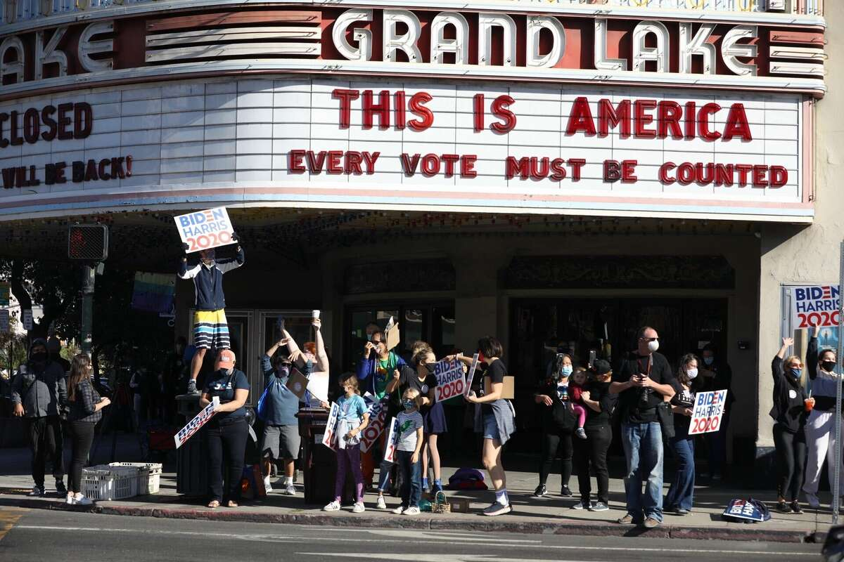 Supporters of Joe Biden and Kamala Harris celebrate their victory in front of the Grand Lake Theater in Oakland, Calif. on Nov. 7 2020.