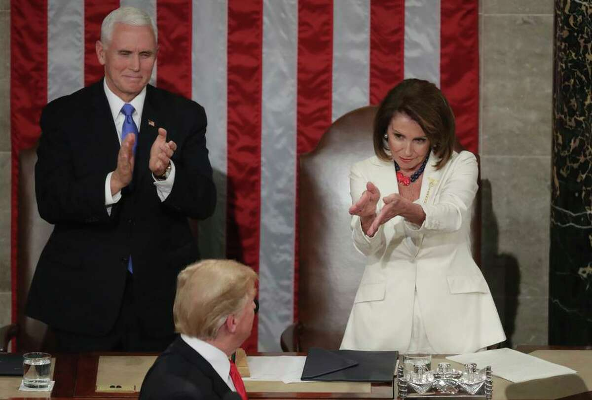 Vice President Mike Pence and House Speaker Nancy Pelosi greet President Trump at the 2019 State of the Union address.