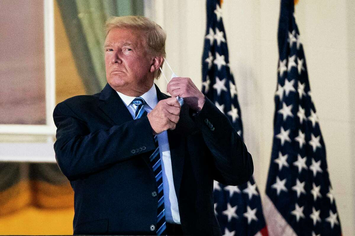 President Donald Trump made a maskless stance at the White House upon returning from treatment for covid-19 at Walter Reed National Military Medical Center. on Oct 5, 2020 in Washington.