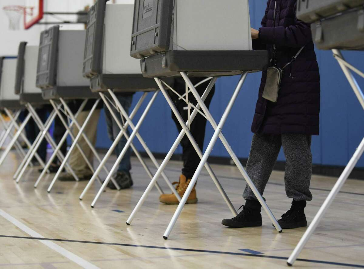 Voters cast their ballots on Election Day 2020 at the District 8 polling center at Central Middle School in Greenwich, Conn. Tuesday, Nov. 3, 2020.