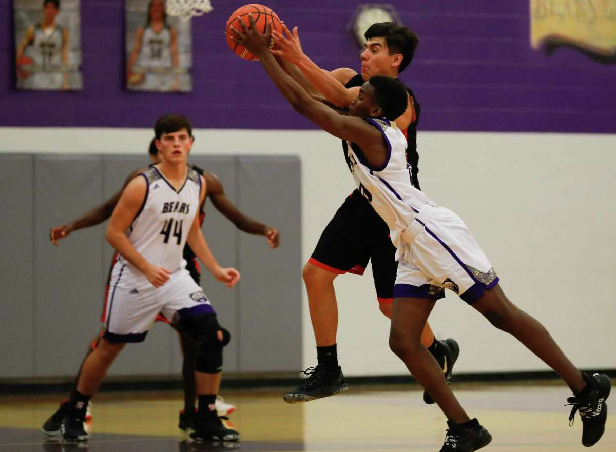 Montgomery point guard Hezzy Miregi (10) collides with Caney Creek guard Adan Maldonado (10) while going for the ball during the second quarter of a District 20-5A high school basketball game at Montgomery High School, Tuesday, Jan. 7, 2020, in Montgomery.