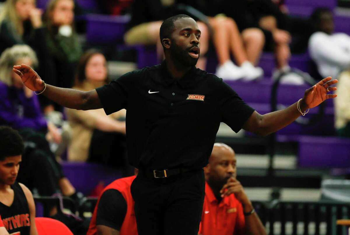 Caney Creek head coach Randy Appiah instructs players during the third quarter of a District 20-5A high school basketball game at Montgomery High School, Tuesday, Jan. 7, 2020, in Montgomery.
