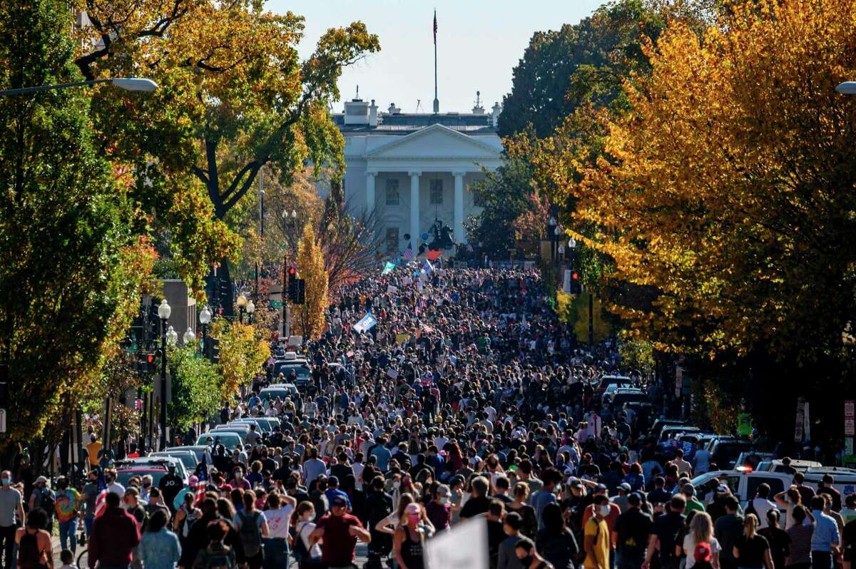 People celebrate on Black Lives Matter plaza across from the White House in Washington, DC on Nov. 7 after Joe Biden was declared the winner of the 2020 presidential election. In other cities, such as New York City and Philadelphia, spontaneous celebrations filled the streets.