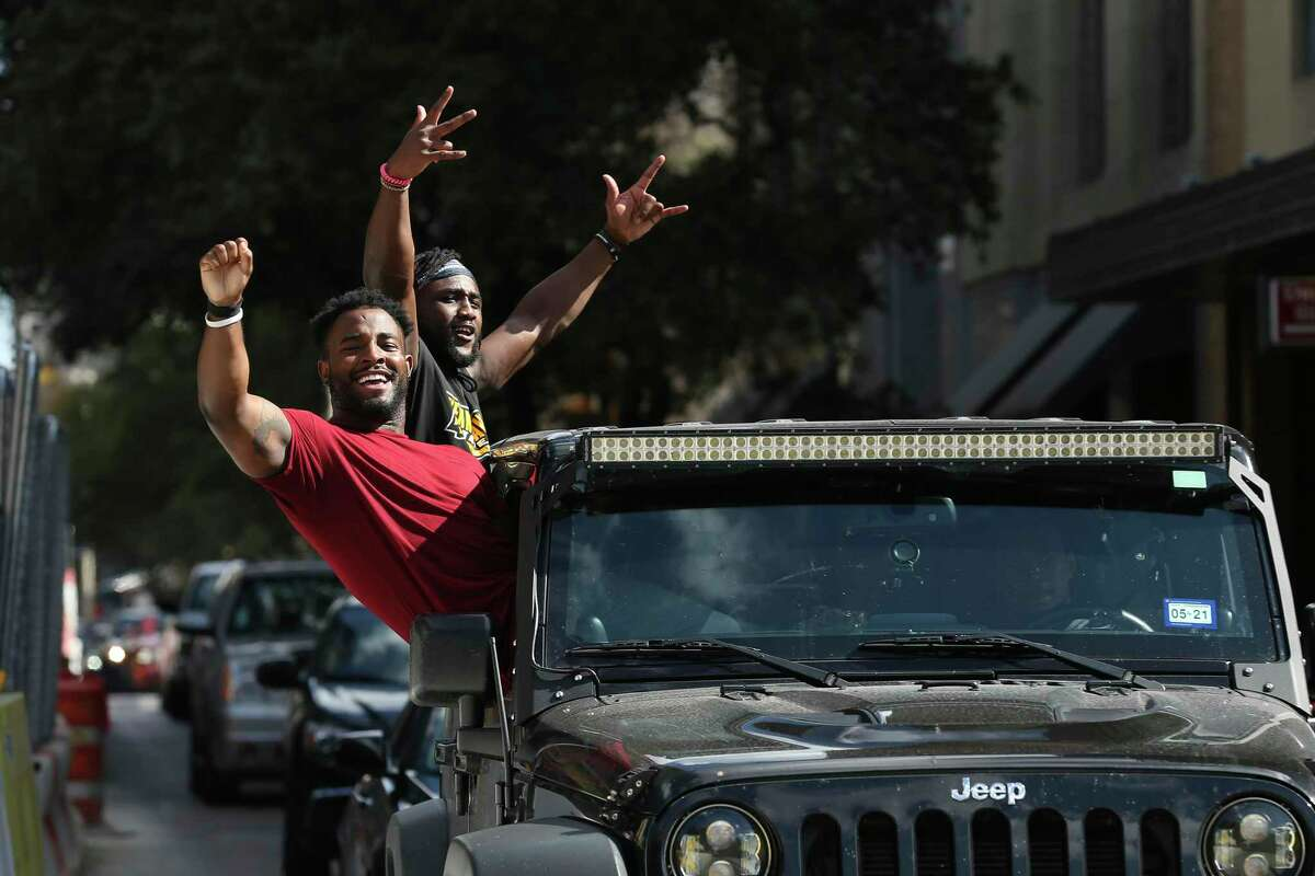 Supporters celebrate the Biden/Harris victory in the 2020 Presidential Elections with a parade around downtown San Antonio, Saturday, Nov. 7, 2020.
