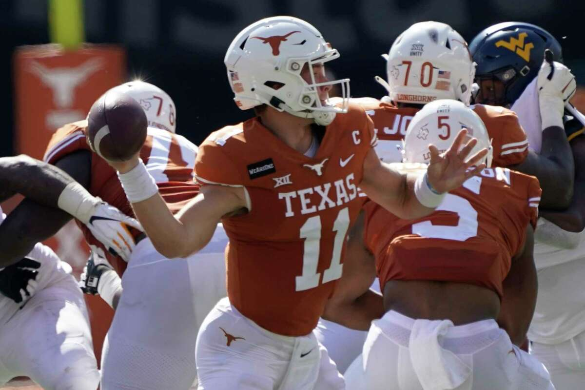 Texas' Sam Ehlinger (11) looks to pass against West Virginia during the first half of an NCAA college football game in Austin, Texas, Saturday, Nov. 7, 2020. (AP Photo/Chuck Burton)