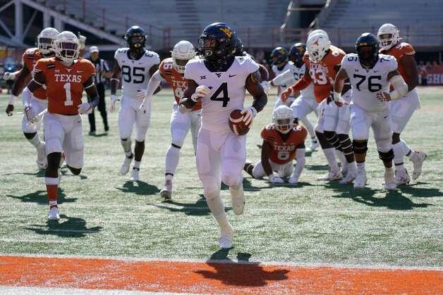 West Virginia's Leddie Brown (4) runs into the end zone for a touchdown against Texas during the first half of an NCAA college football game in Austin, Texas, Saturday, Nov. 7, 2020. (AP Photo/Chuck Burton) Photo: Chuck Burton, Associated Press / Copyright 2020 The Associated Press. All rights reserved.