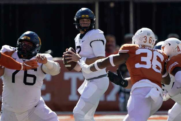 West Virginia quarterback Jarret Doege (2) looks to pass against Texas during the first half of an NCAA college football game in Austin, Texas, Saturday, Nov. 7, 2020. (AP Photo/Chuck Burton) Photo: Chuck Burton, Associated Press / Copyright 2020 The Associated Press. All rights reserved.