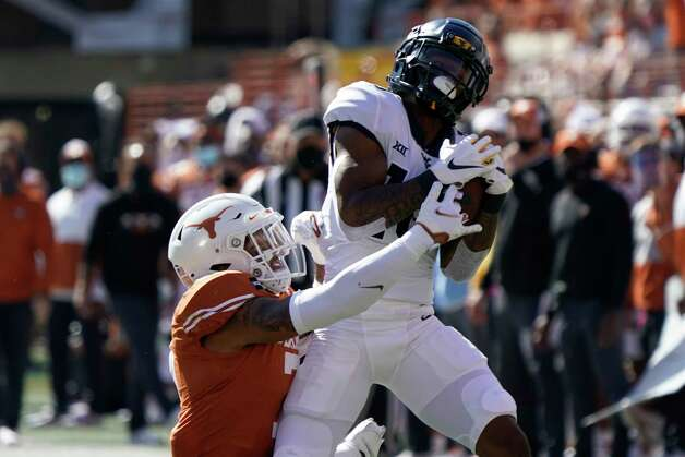 West Virginia's Winston Wright Jr., right, catches a pass against Texas' Caden Sterns, left, during the first half of an NCAA college football game in Austin, Texas, Saturday, Nov. 7, 2020. (AP Photo/Chuck Burton) Photo: Chuck Burton, Associated Press / Copyright 2020 The Associated Press. All rights reserved.