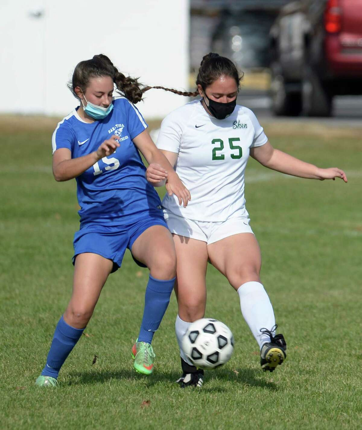 Shen?•s Leila Bennett gets to the ball before Saratoga?•s Amanda Marcolin during a game Saturday, Nov. 7, 2020, at Saratoga Springs High School in Saratoga Springs, N.Y. (Jenn March, Special to the Times Union )