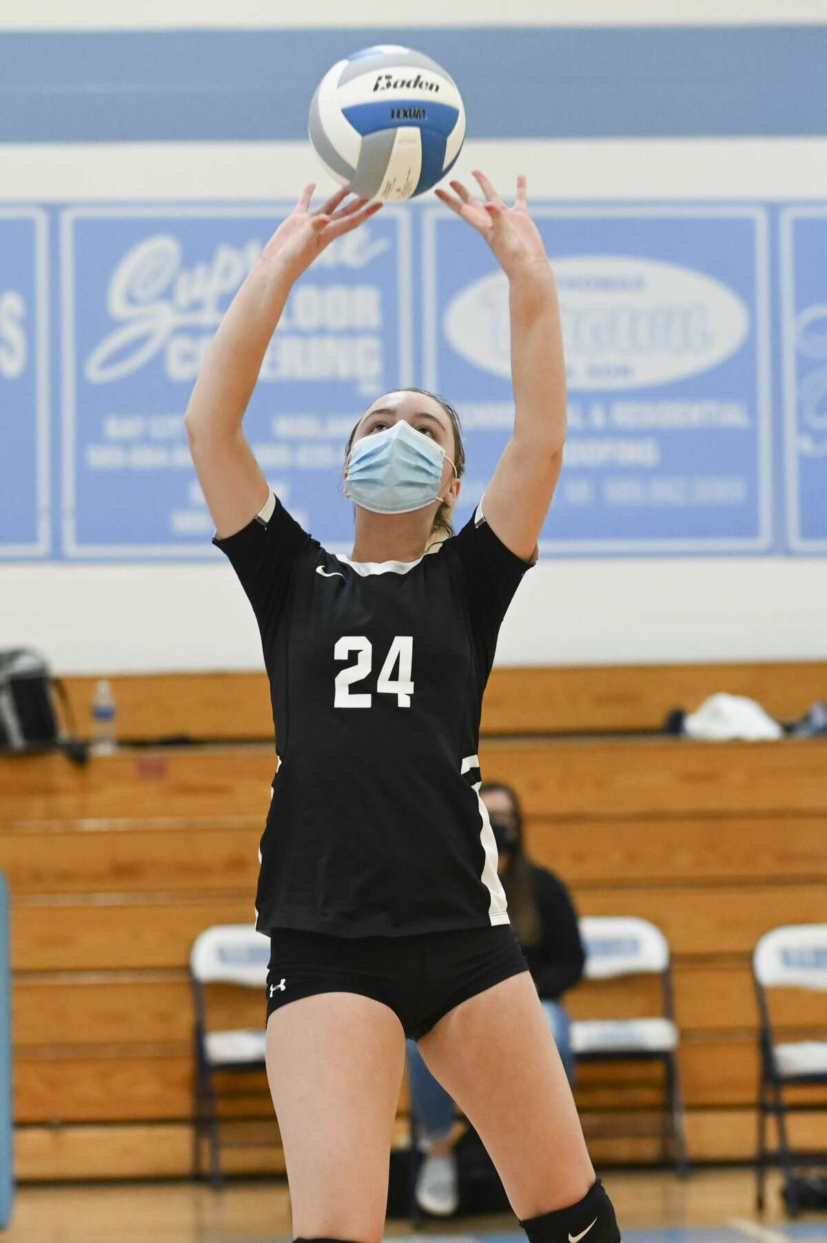 Bullock Creek's Vivian Freeland sets the ball during a district final against Garber Saturday, Nov. 7, 2020 at Garber High School. (Adam Ferman/for the Daily News)