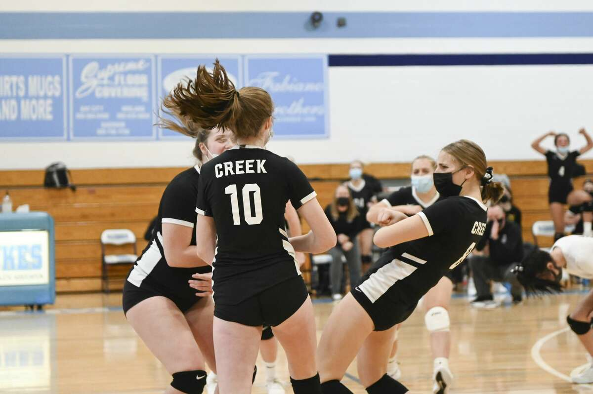 Bullock Creek celebrates a point during a district final against Garber Saturday, Nov. 7, 2020 at Garber High School. (Adam Ferman/for the Daily News)