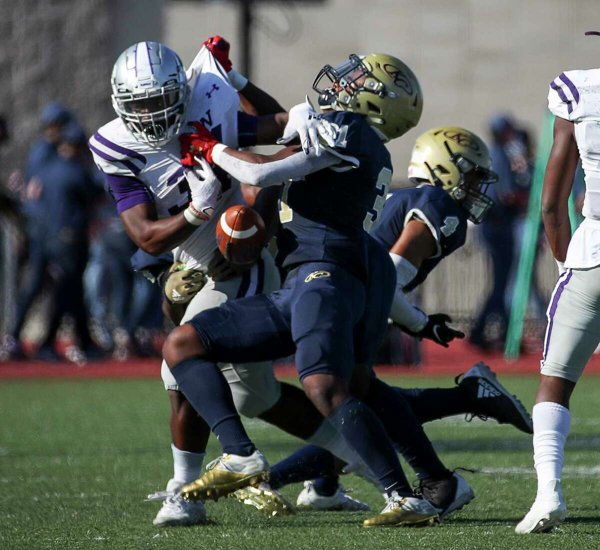 Klein Cain Hurricanes running back Aaron Jordan (34) fumbles the ball after being hit by Klein Collins Tigers defensive back Addison Luke Taylor (31) during the first half of a high school football game Saturday, Nov. 7, 2020, at Klein Memorial Stadium in Spring.