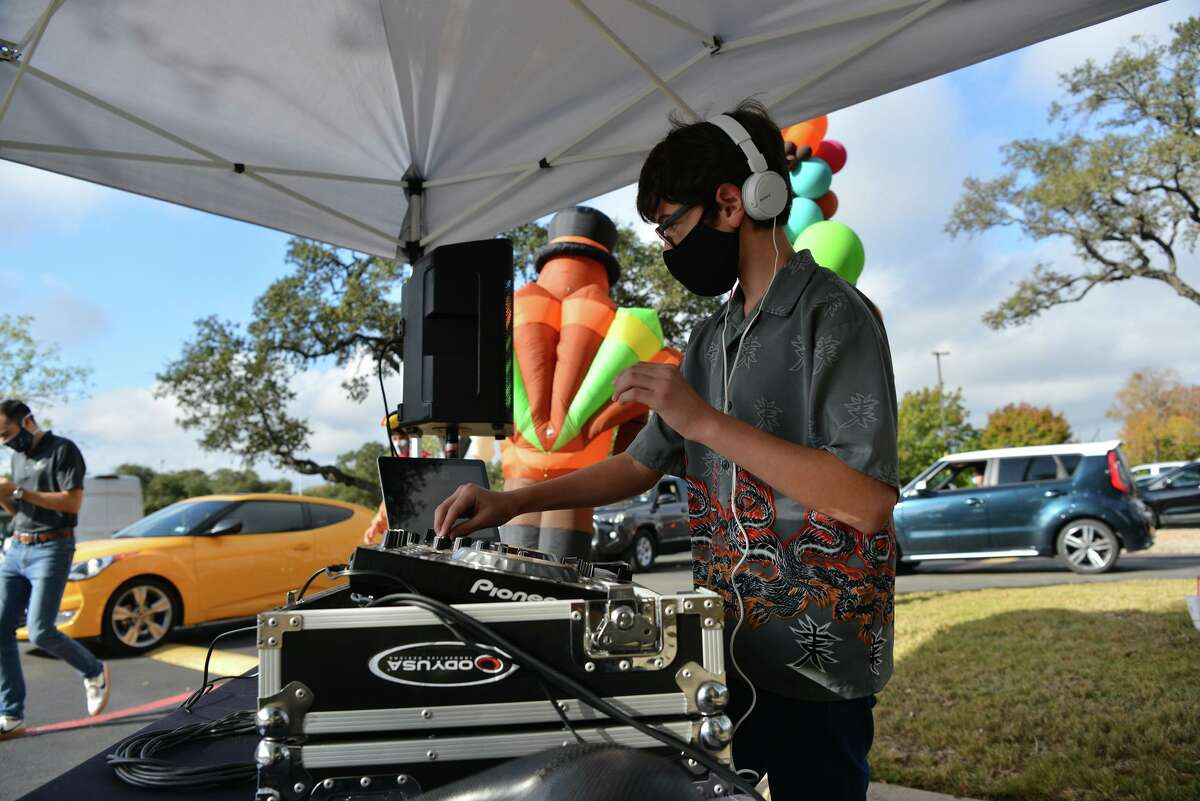Frank Lucci is the dj playing music as employee's and volunteers of Fristmark Credit Union hand out 1000 turkey's to 1000 teachers Saturday in the parking lot of their Gold Canyon Dr. location. Teachers were also given classroom supplies and swag bags filled with donated items from community members.