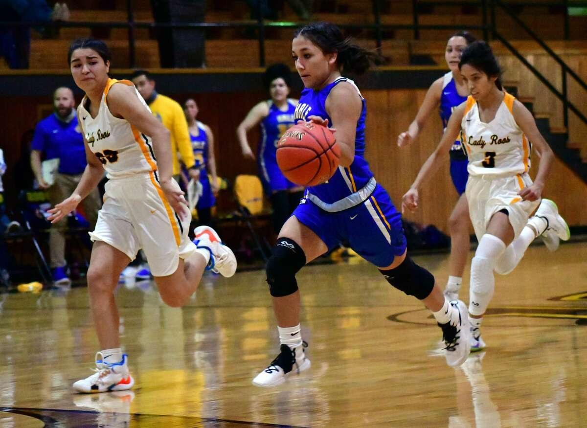 Hale Center's Jaclyn Alcala races up the floor past a pair of Kress defenders during their non-district high school girls basketball game on Nov. 7, 2020 in Kress.
