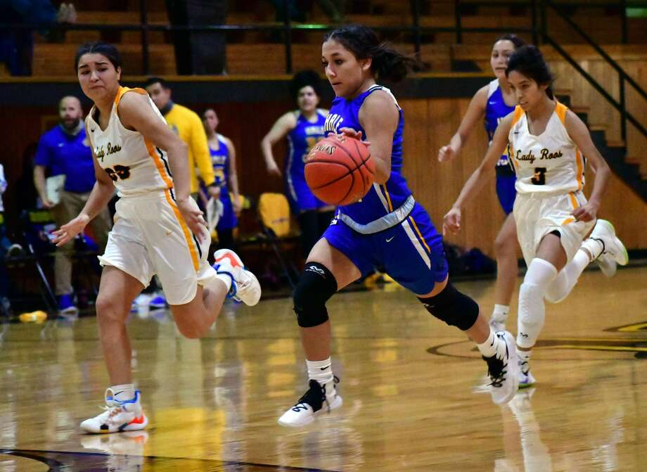 Hale Center's Jaclyn Alcala races up the floor past a pair of Kress defenders during their non-district high school girls basketball game on Nov. 7, 2020 in Kress. Photo: Nathan Giese/Planview Herald